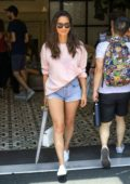 Olivia Munn rocks pink sweater and denim shorts while leaving her hotel during 2019 Comic-Con in San Diego, California