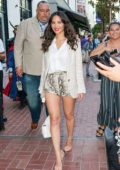 Olivia Munn shows off her toned legs in snakeskin shorts as she arrives at 2019 Comic-Con in San Diego, California