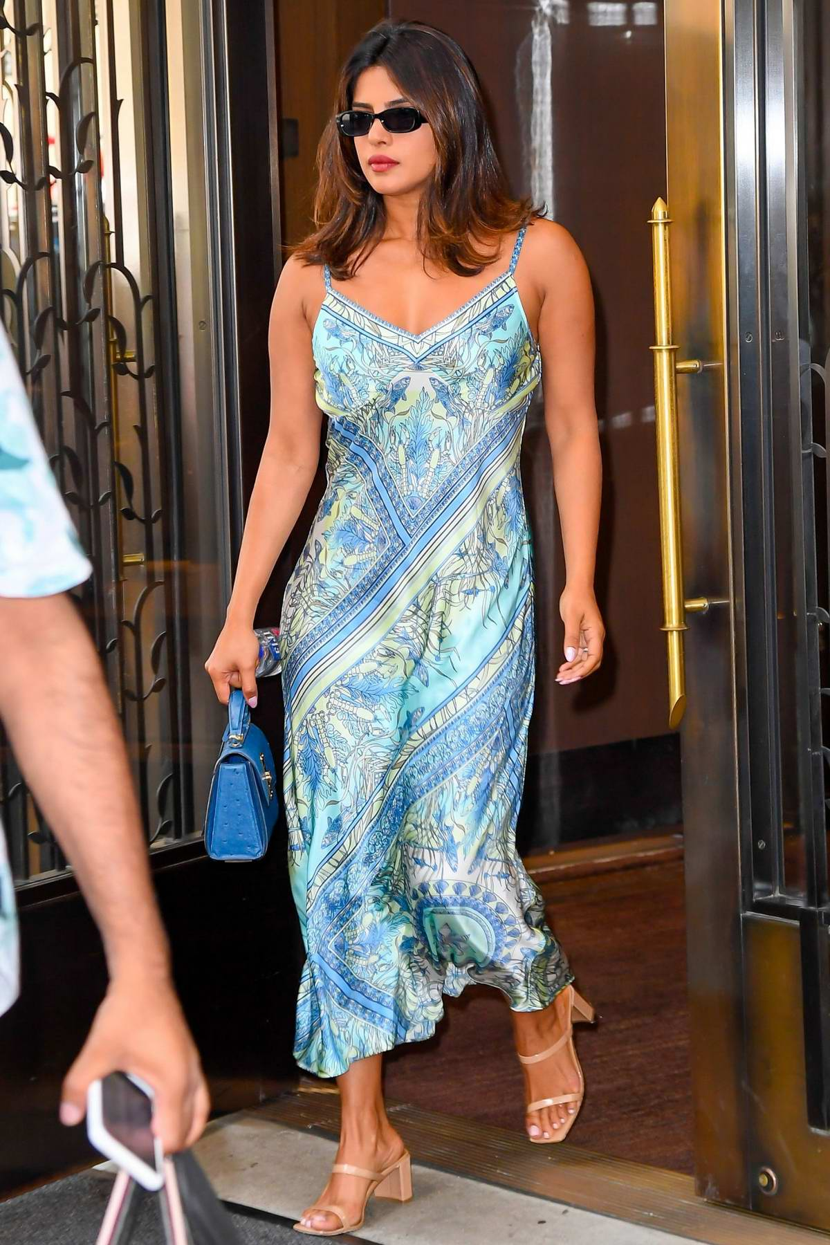 Priyanka Chopra seen wearing a blue floral print dress as she heads out in New York City