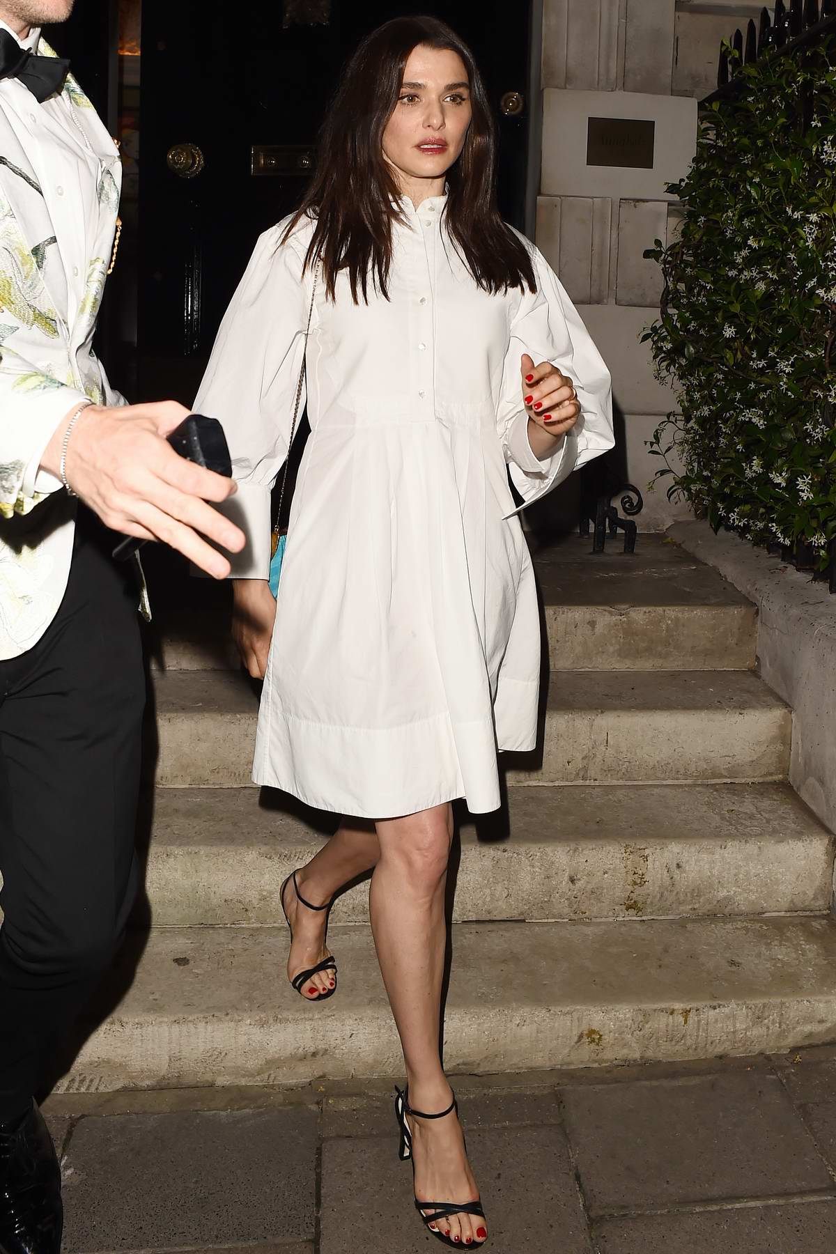 Rachel Weisz looks classy in a white dress as she leaves Annabel's Club in London, UK