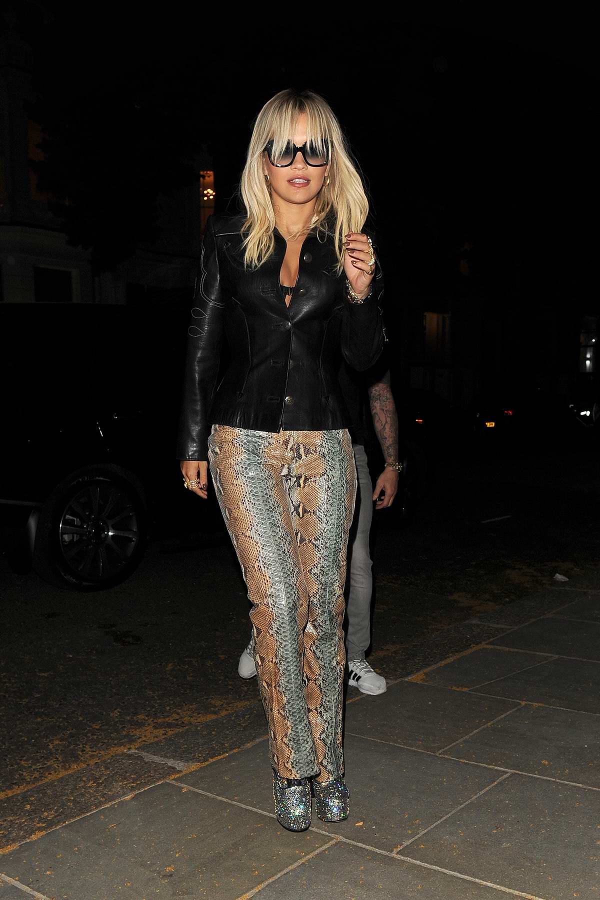 Rita Ora rocks black leather jacket and snakeskin pants while attending Amazon's Prime Day party in London, UK