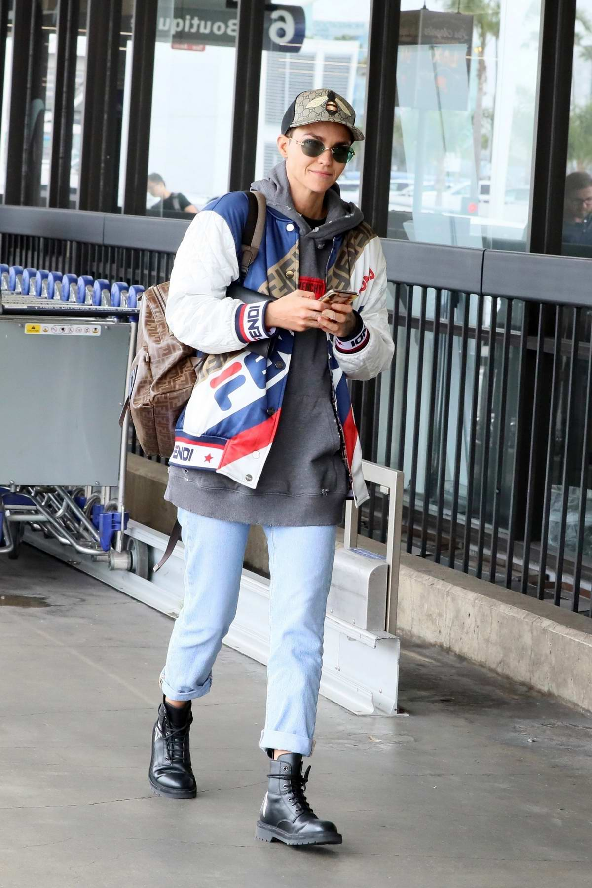 Ruby Rose rocks Givenchy sweatshirt with a Fendi jacket as she arrives for a flight out of LAX in Los Angeles