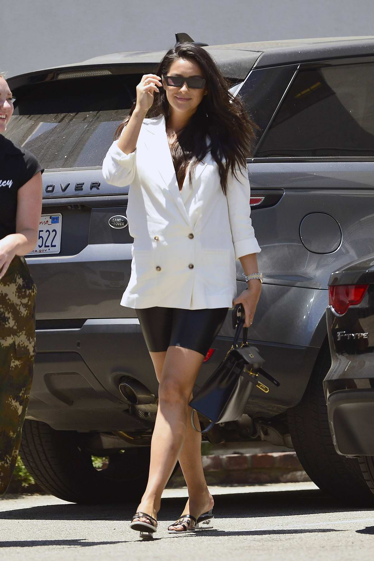 Shay Mitchell rocked a white blazer with black biker shorts during a lunch outing with friends in Los Angeles