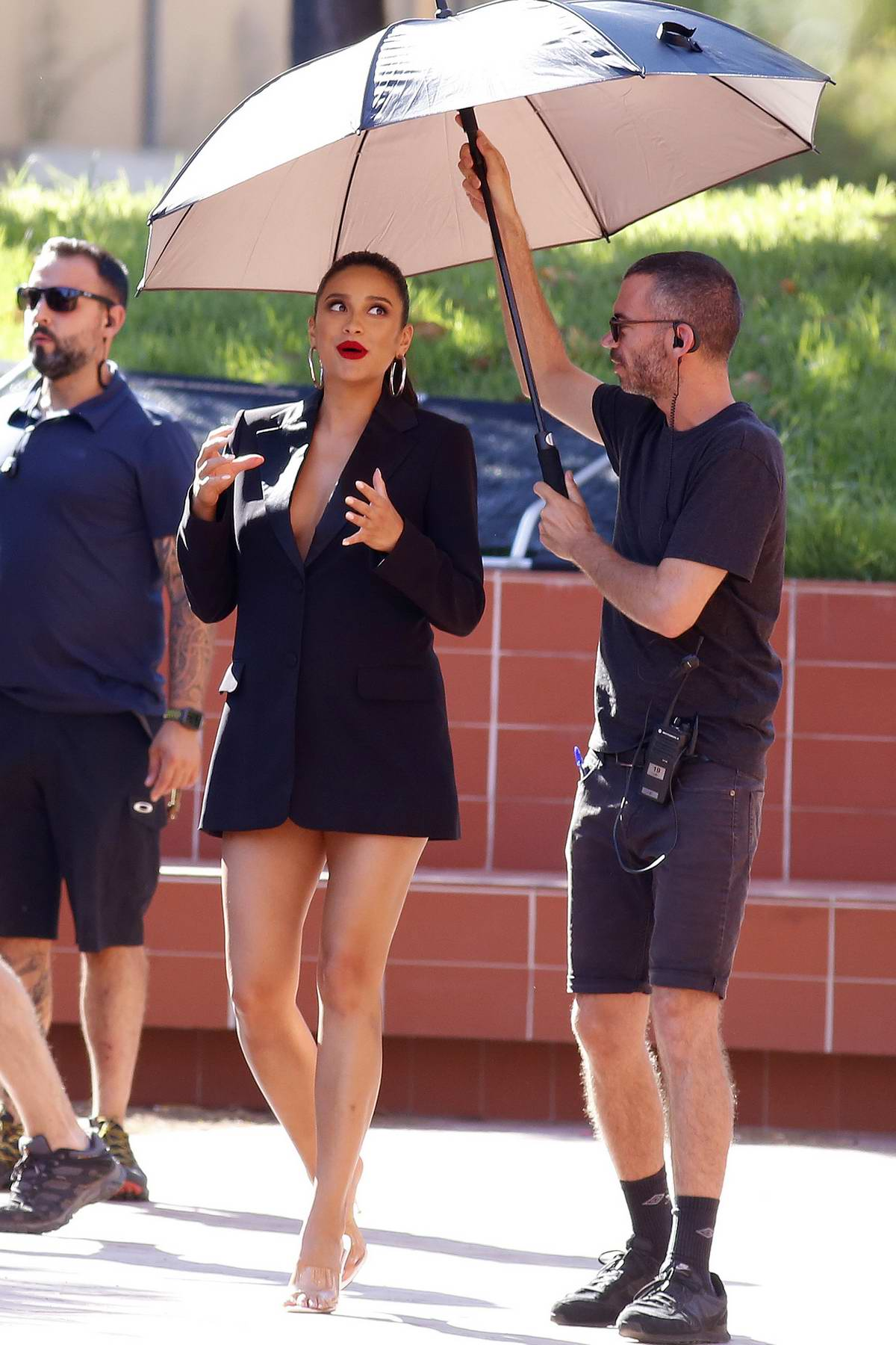Shay Mitchell puts her legs on display in a black blazer during a shoot in Barcelona, Spain