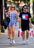 Sophie Turner wears a blue plaid minidress during a shopping trip to Extra Butter with Joe Jonas in New York City