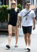 Sophie Turner wears black top and denim shorts for a casual stroll with Joe Jonas in New York City
