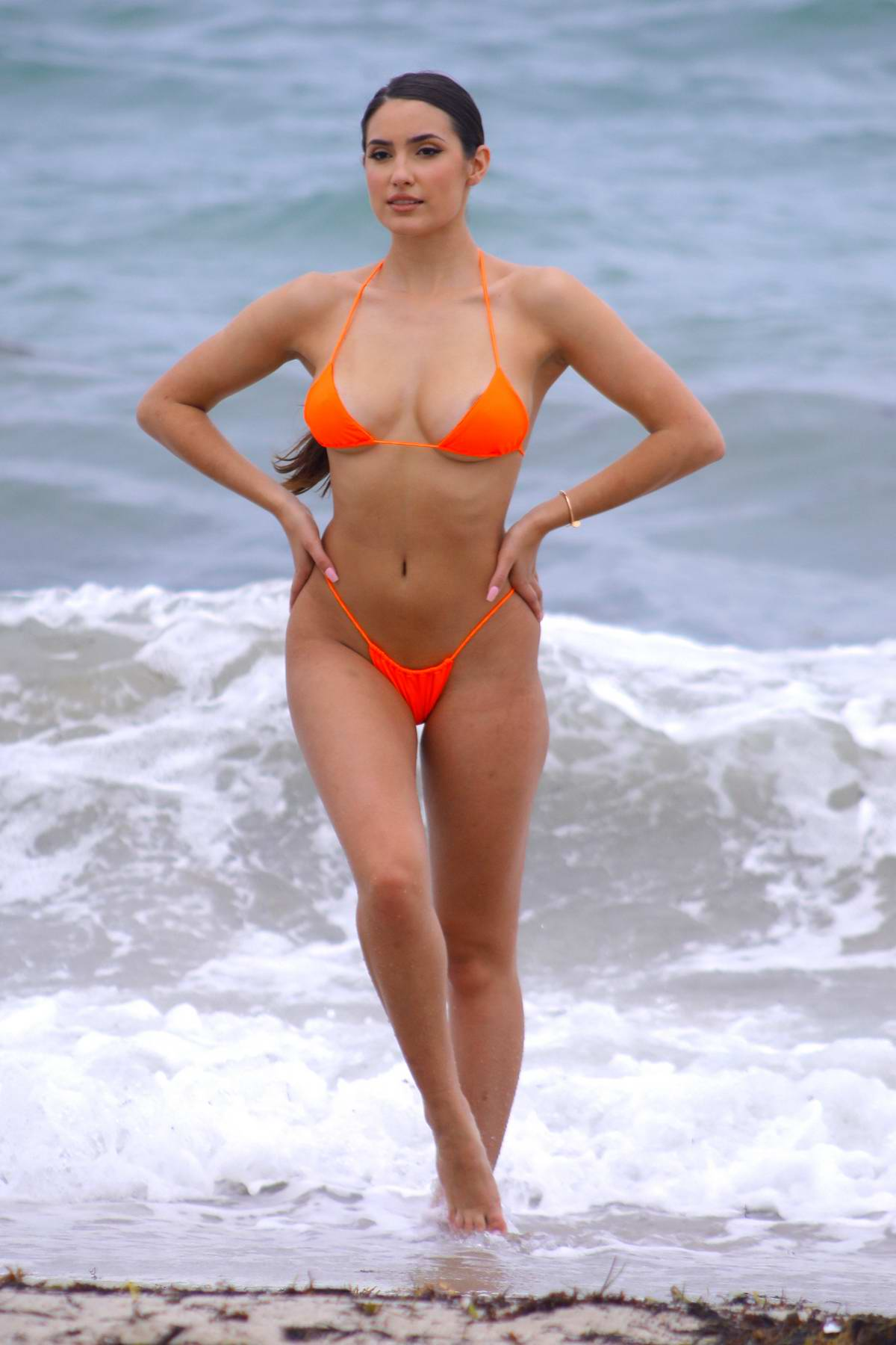Tao Wickrath hits the beach in a bright orange bikini during Miami Swim Week in Miami Beach, Florida