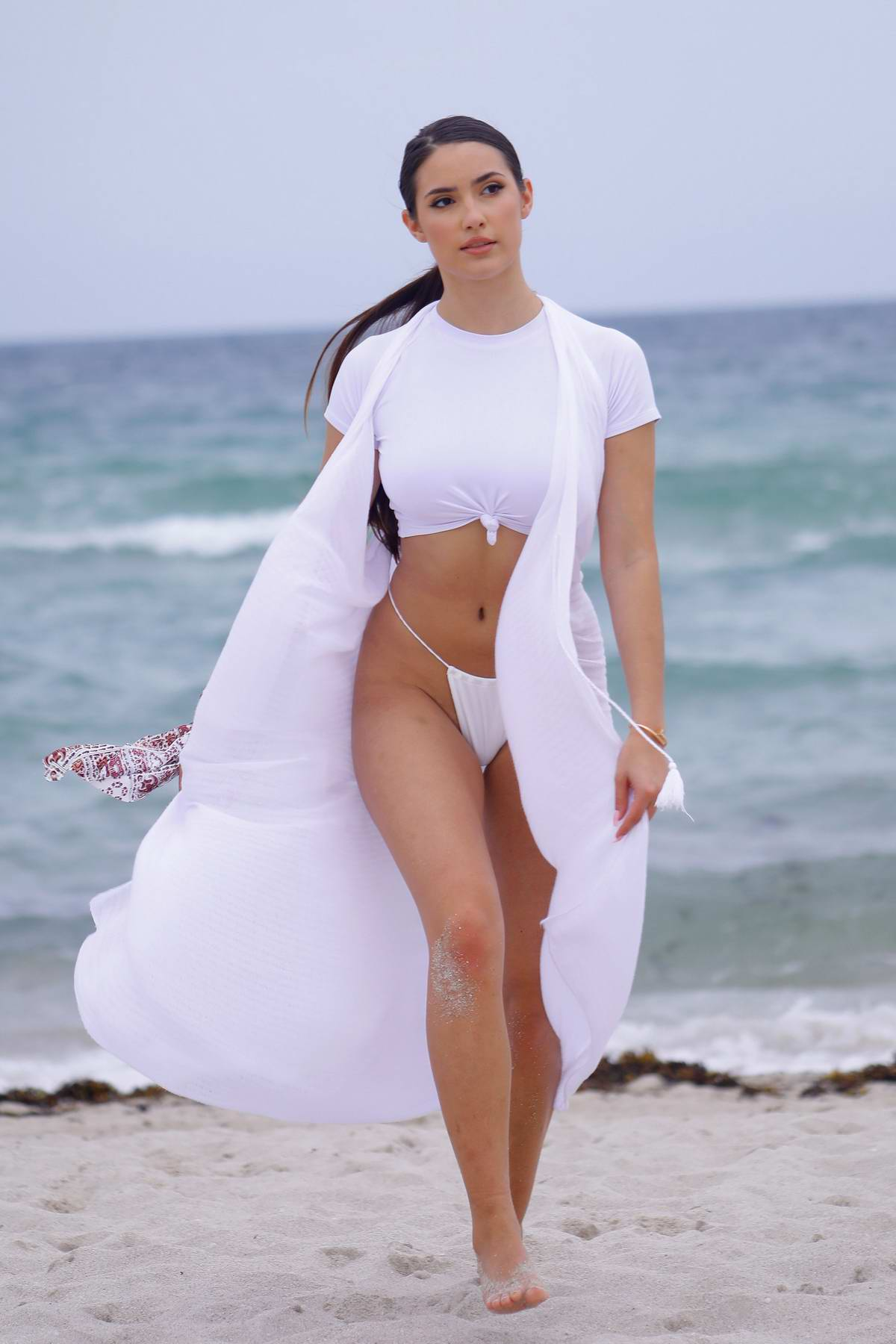 Tao Wickrath sizzles in a flowing white bikini on Miami Beach, Florida