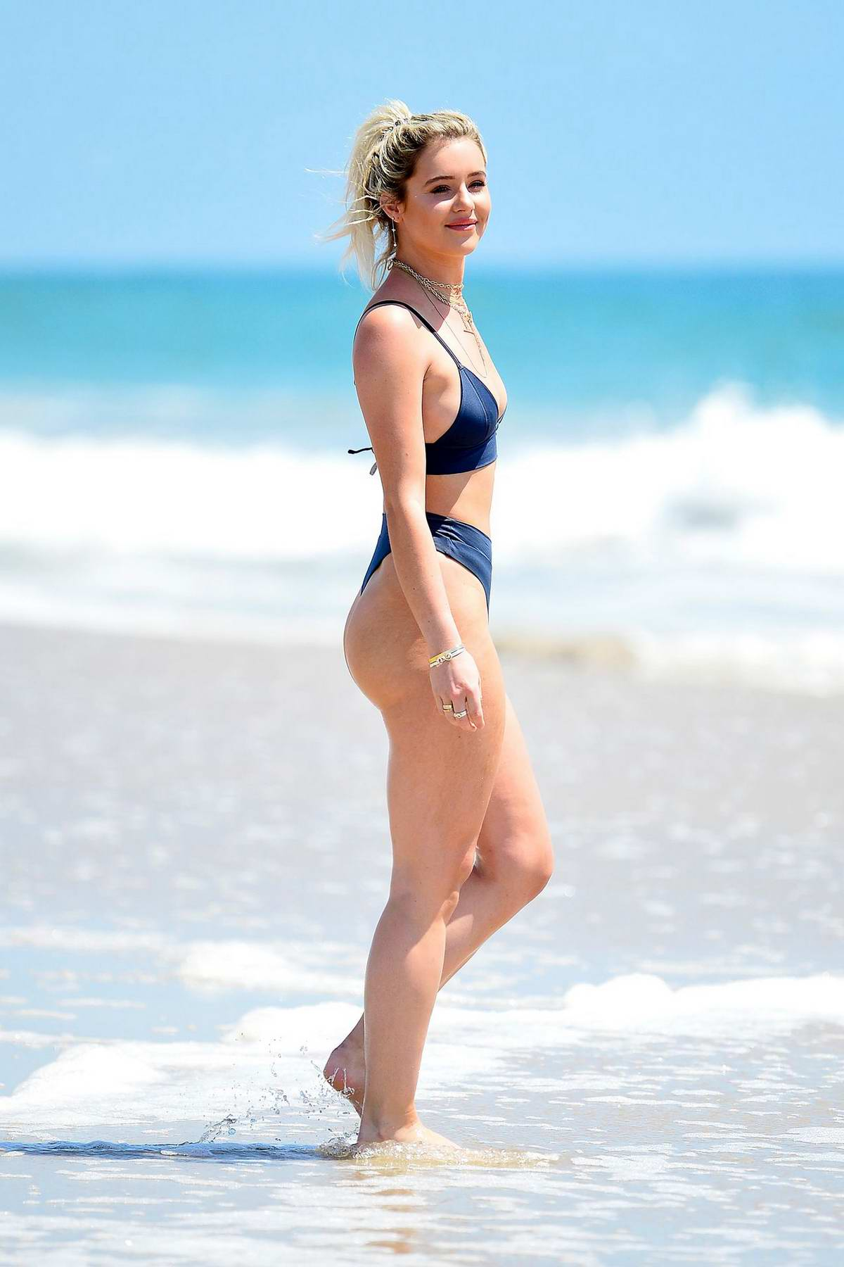 Tina Stinnes wears a blue BooHoo bikini while enjoying the beach in Miami, Florida