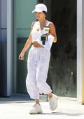 Vanessa Hudgens dons all white as she stop by a gas station to fuel up her car in Los Angeles