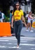 Victoria Justice seen wearing a yellow 'Out of Office' top while out for a stroll in New York City
