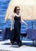 Zoey Deutch enjoys some downtime with her boyfriend at the beach in Ischia, Italy