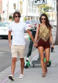 Alessandra Ambrosio and Nicolo Oddi hold hands as they step out for a romantic stroll in Los Angeles