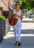 Alessandra Ambrosio dons all-white athleisure ensemble as she exits a pilates studio in Los Angeles