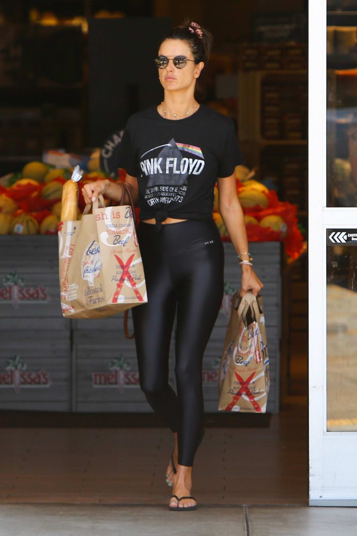 Alessandra Ambrosio rocks 'Pink Floyd' T-shirt and black leggings while shopping groceries in Los Angeles