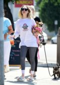 Alessandra Torresani runs errands with her dog in Studio City, Los Angeles