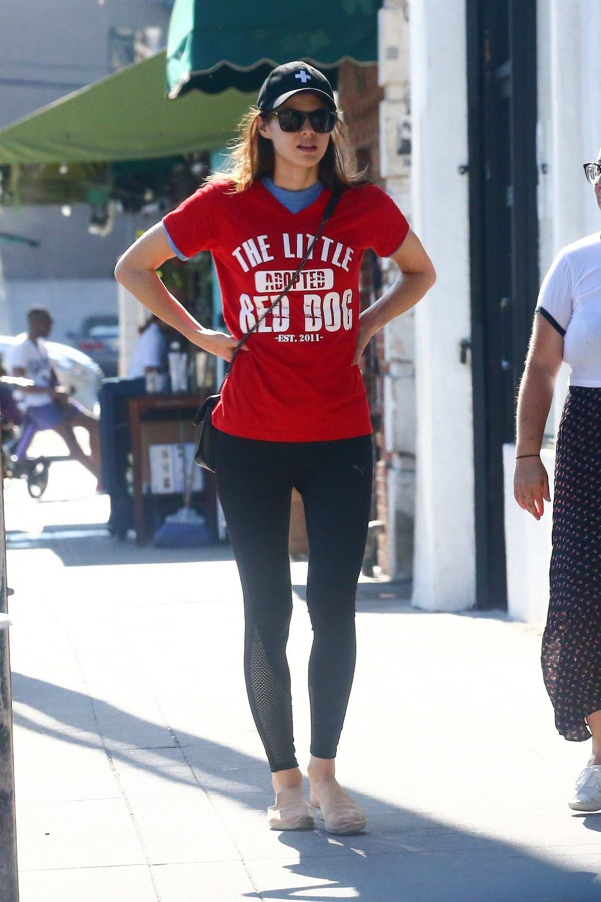 Alexandra Daddario sports a red t-shirt and black leggings as she stepped out for lunch with Kimiko Glenn in Los Angeles