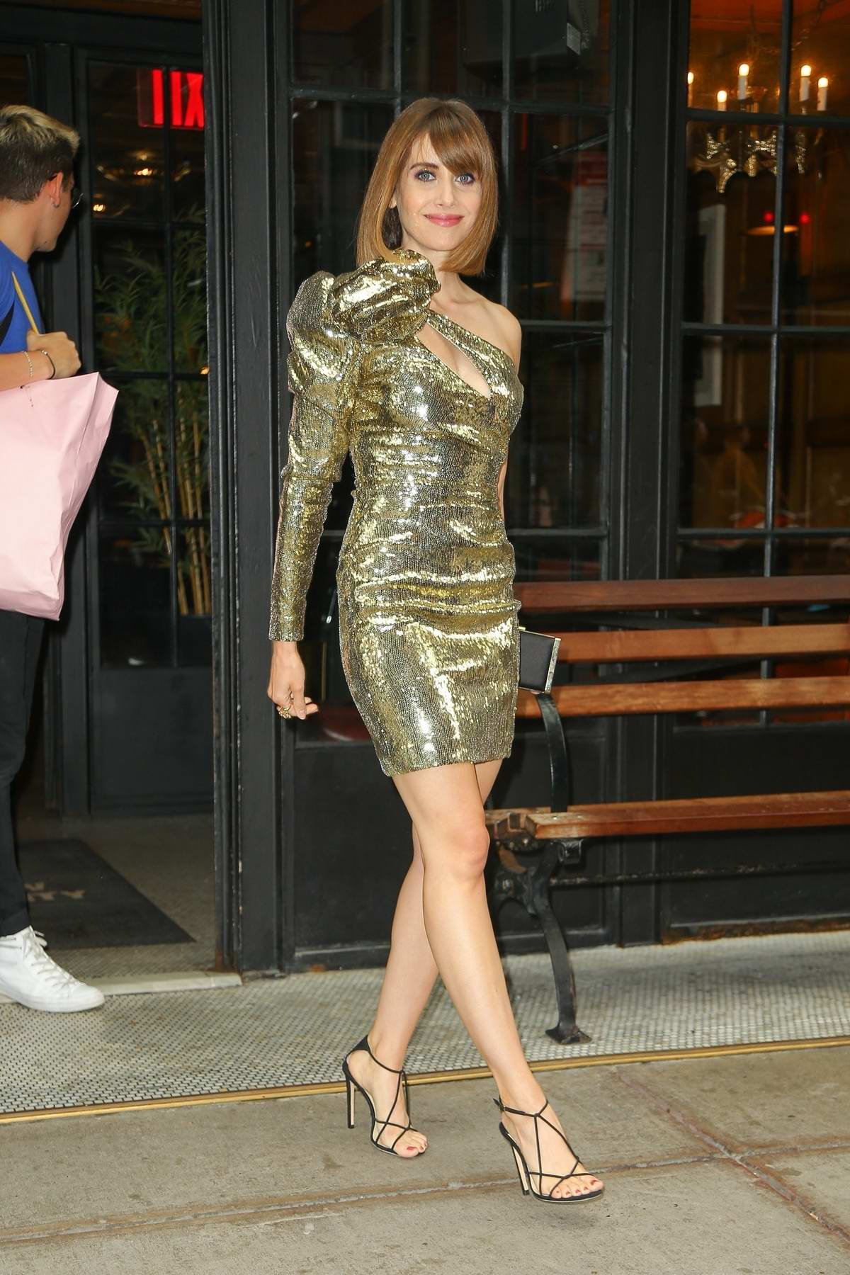 Alison Brie shimmers in gold as she leaves The Ludlow Hotel in New York City