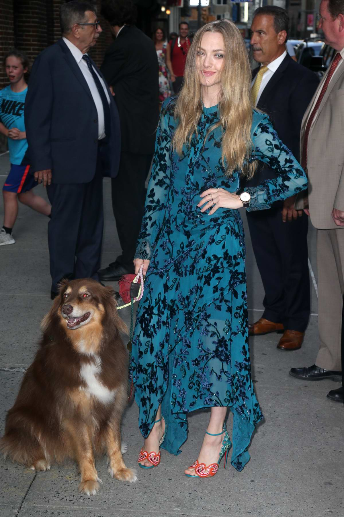 Amanda Seyfried poses with her dog Finn while visiting 'The Late Show With Stephen Colbert' in New York City