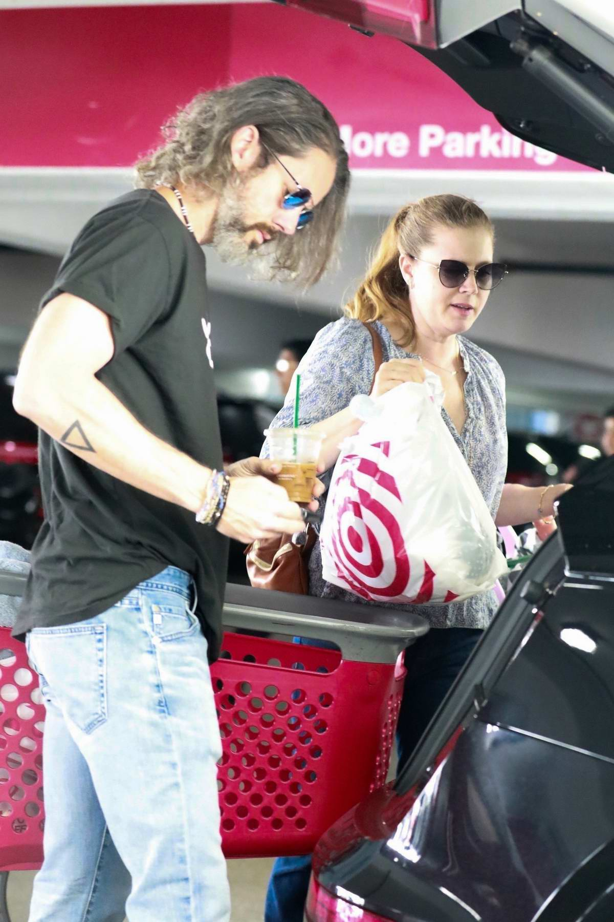 Amy Adams shops for groceries with her husband and daughter at Target in Los Angeles