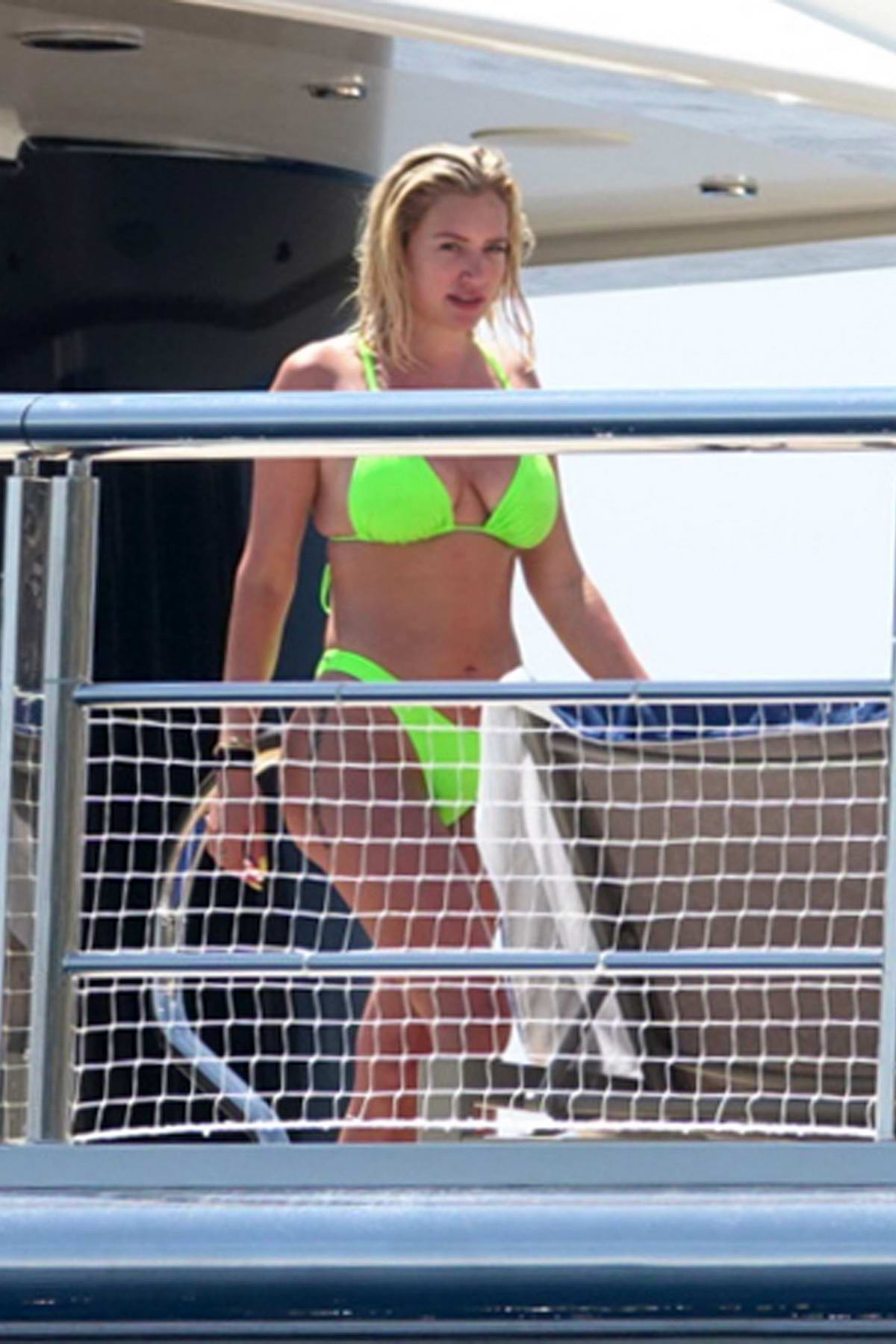 Anastasia Karanikolaou looks striking in a lime green bikini while enjoying a day on a yacht in Positano, Italy