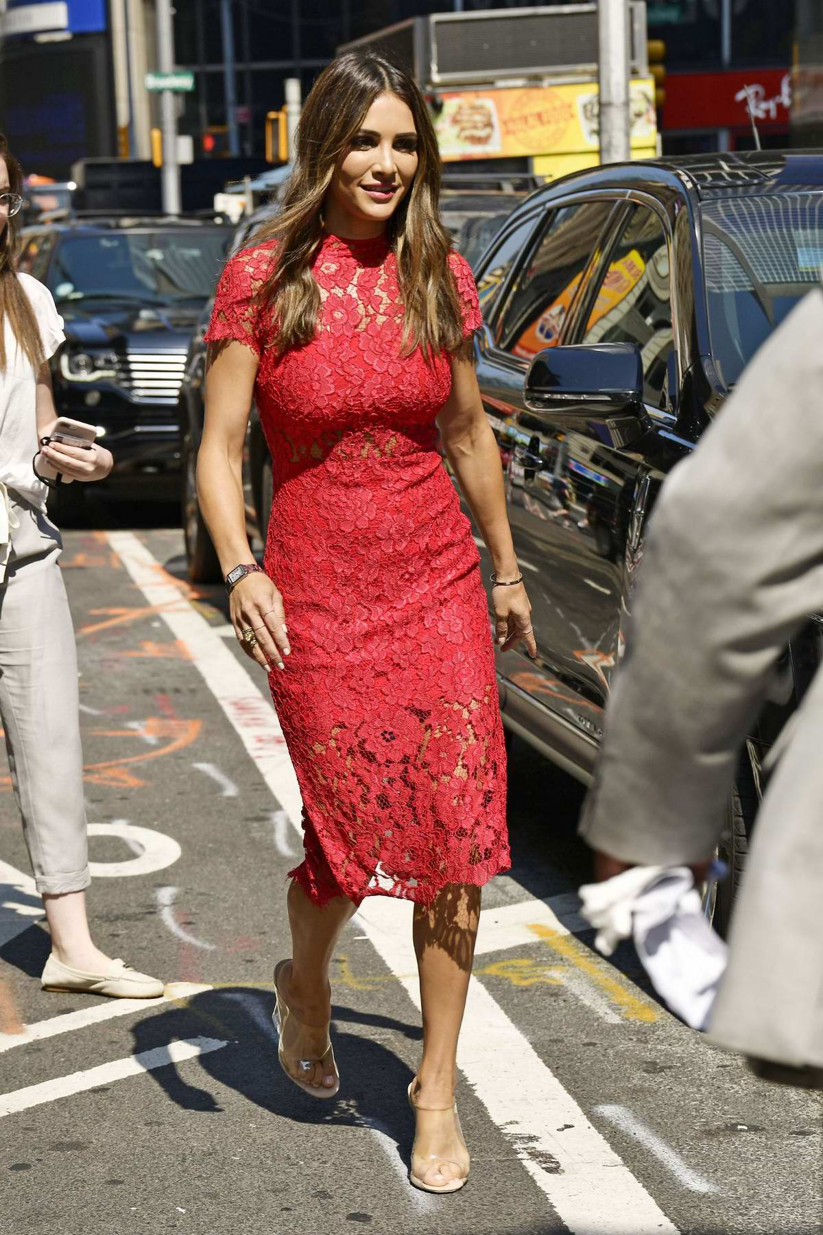 Andi Dorfman looks lovely in a red dress white out in New York City
