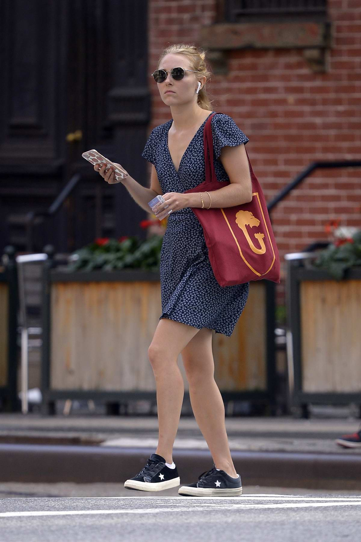 AnnaSophia Robb keeps it casual in a floral summer dress and sneakers while out in New York City