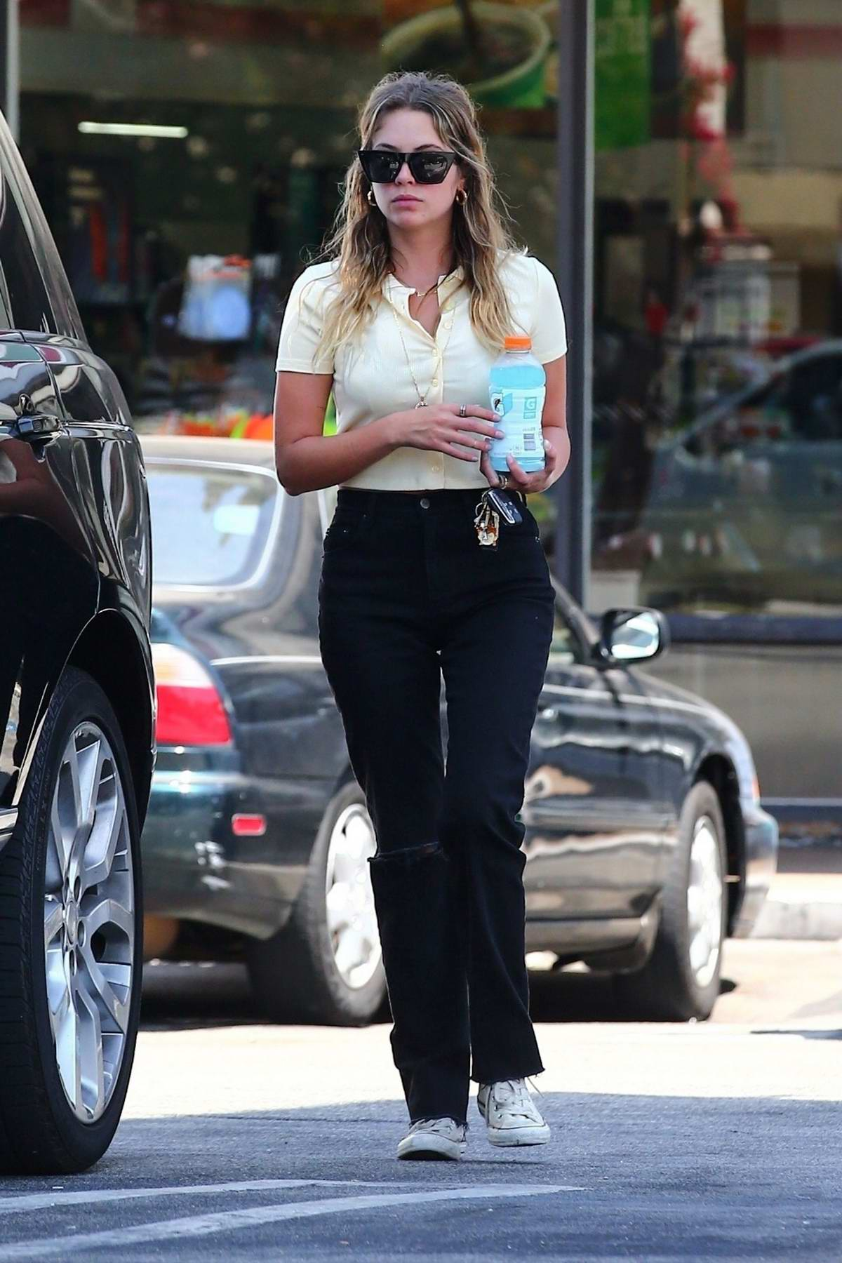 Ashley Benson grabs a drink at 7 Eleven before visiting a nail salon in Studio City, Los Angeles