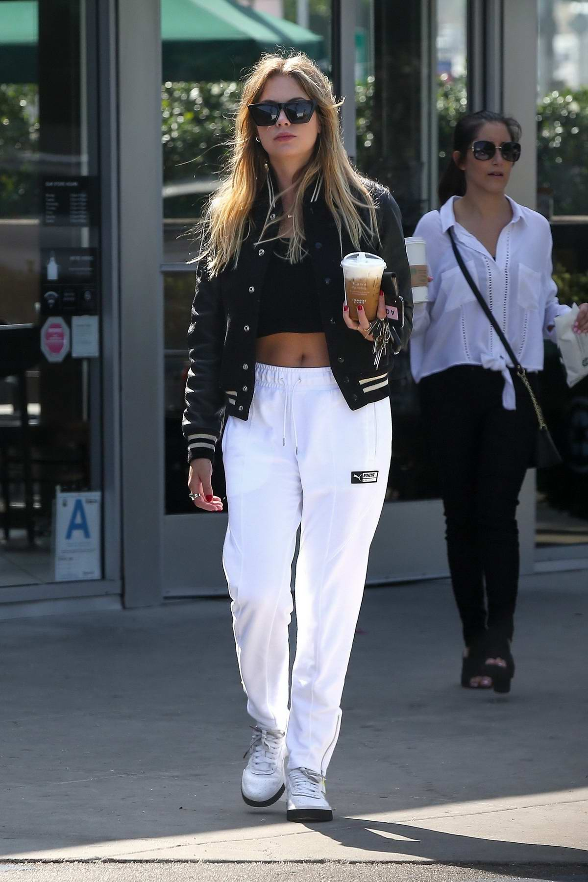Ashley Benson grabs her daily Starbucks coffee while out in West Hollywood, Los Angeles
