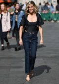 Ashley Roberts seen wearing a black corset top and flared jeans as she leaves Heart Radio studios in London, UK