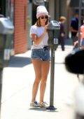 Ashley Tisdale looks cute in a pink beanie paired with a white top and denim shorts while out in Beverly Hills, Los Angeles