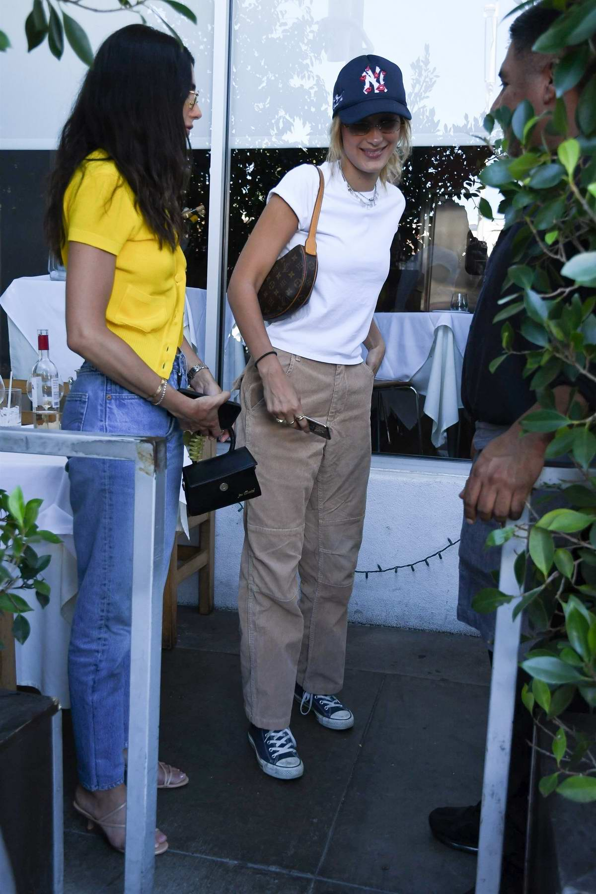 Bella Hadid smiles for the shutterbugs as she leaves after lunch at E Baldi in Beverly Hills, Los Angeles
