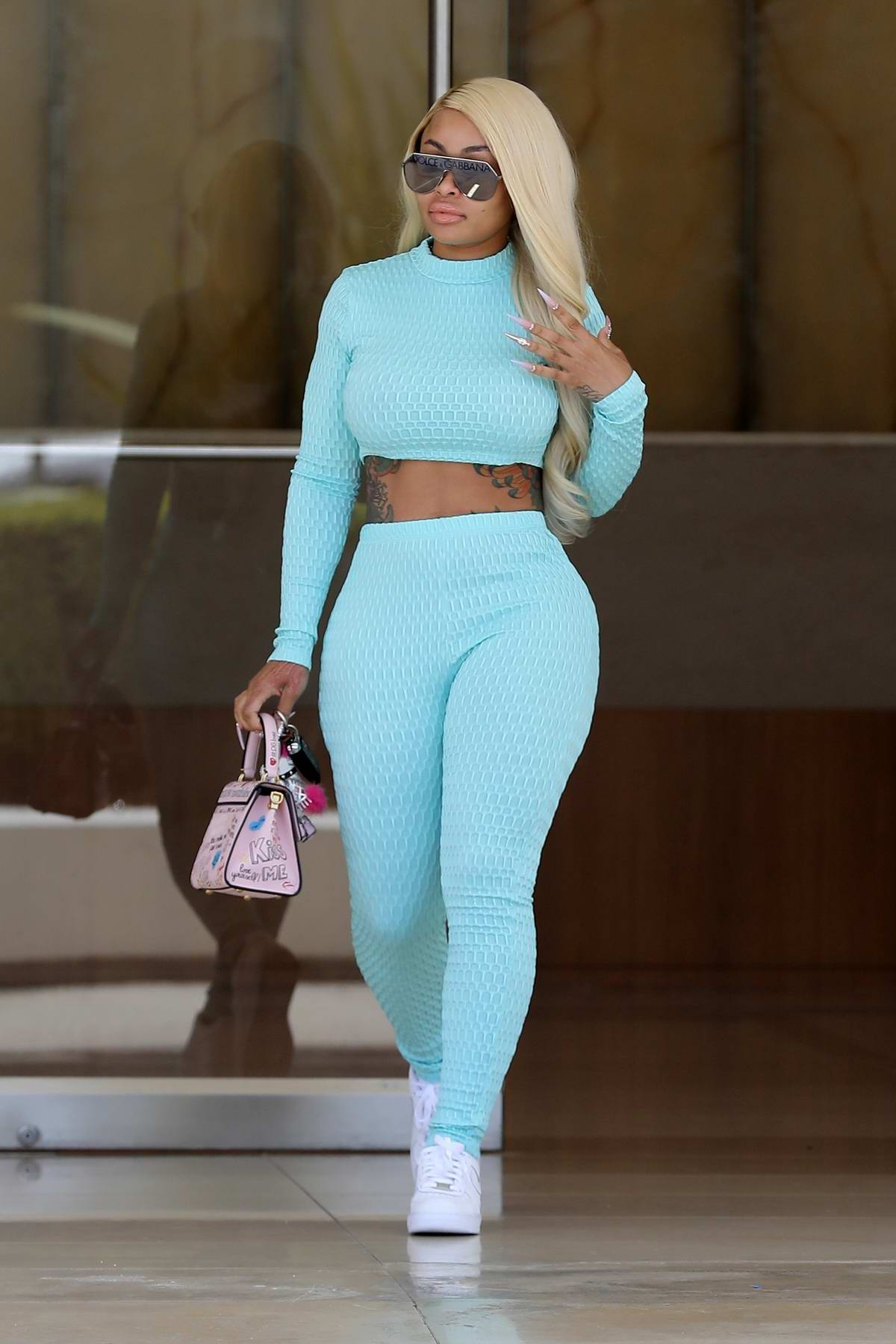 Blac Chyna sports baby blue crop top and matching leggings as she leaves an office building in Beverly Hills, Los Angeles