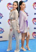 Brie and Nikki Bella attend the FOX's Teen Choice Awards 2019 in Hermosa Beach, California