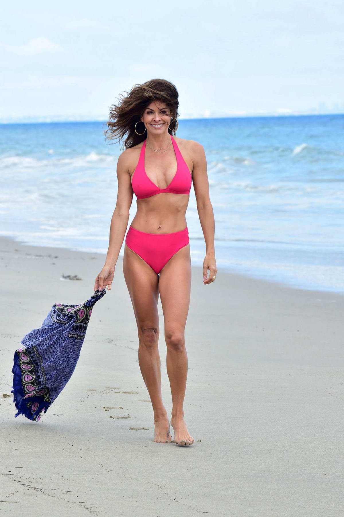 Brooke Burke sports a pink bikini while filming another video for her 'BrookeBurkeBody' app at the beach in Malibu, California