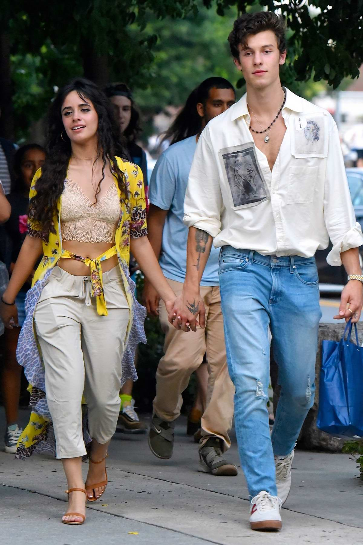 Camila Cabello and Shawn Mendes are all smiles as they hold hands and stroll through the streets of New York City