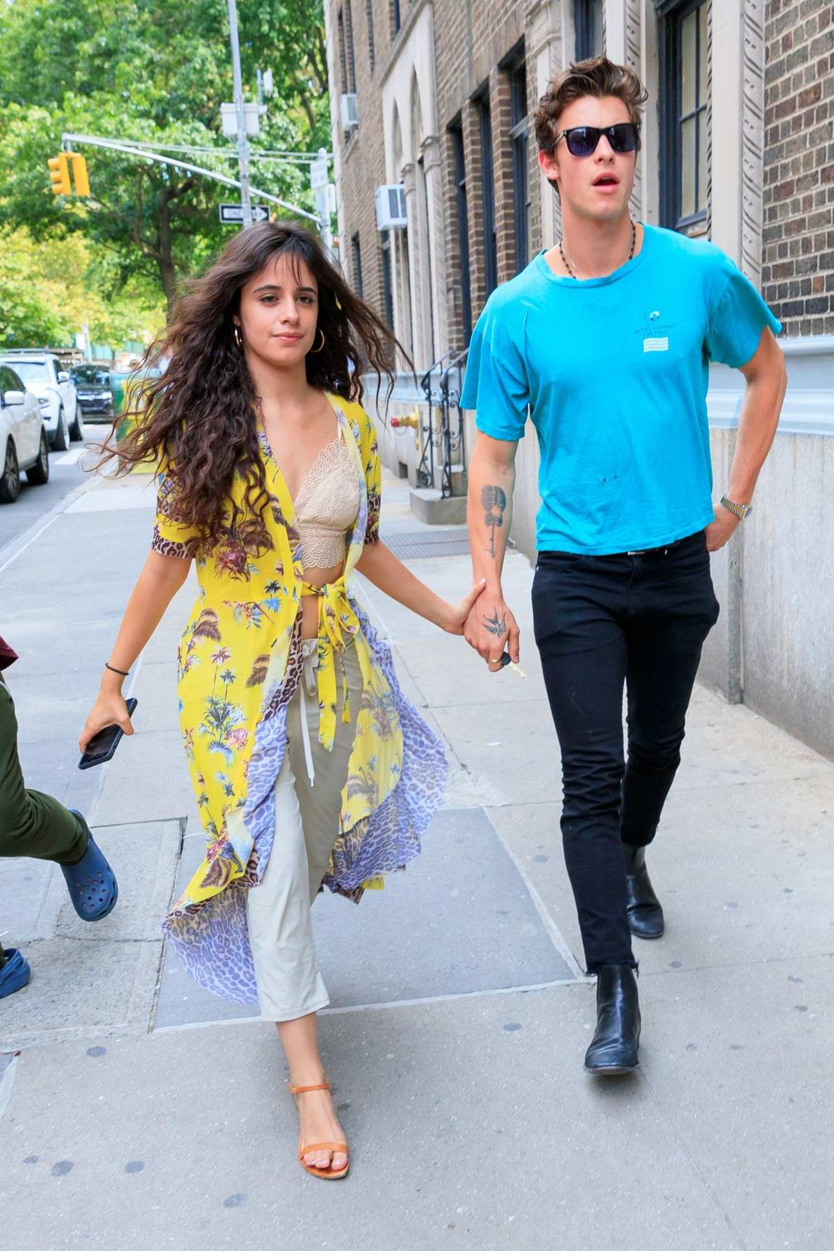 Camila Cabello and Shawn Mendes seen arriving at an apartment building in New York City