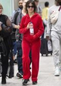 Camila Cabello seen wearing a bright red sweatsuit as she arrives at the JFK airport with her mother in New York City