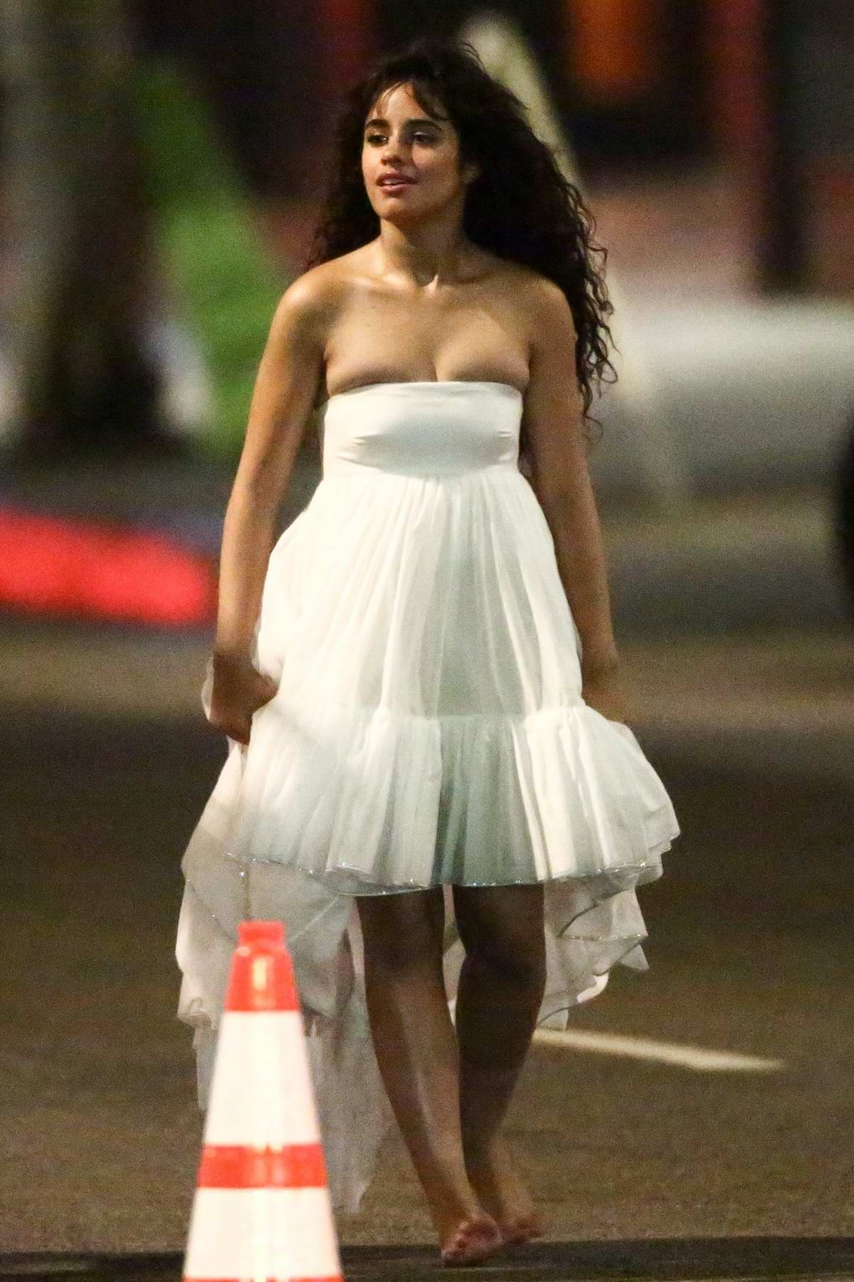 Camila Cabello seen wearing a white dress while filming a new music video in Los Angeles