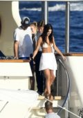 Camila Morrone spotted in a white bikini top on a yacht as she continues her vacation with Leonardo DiCaprio in Sardinia, Italy