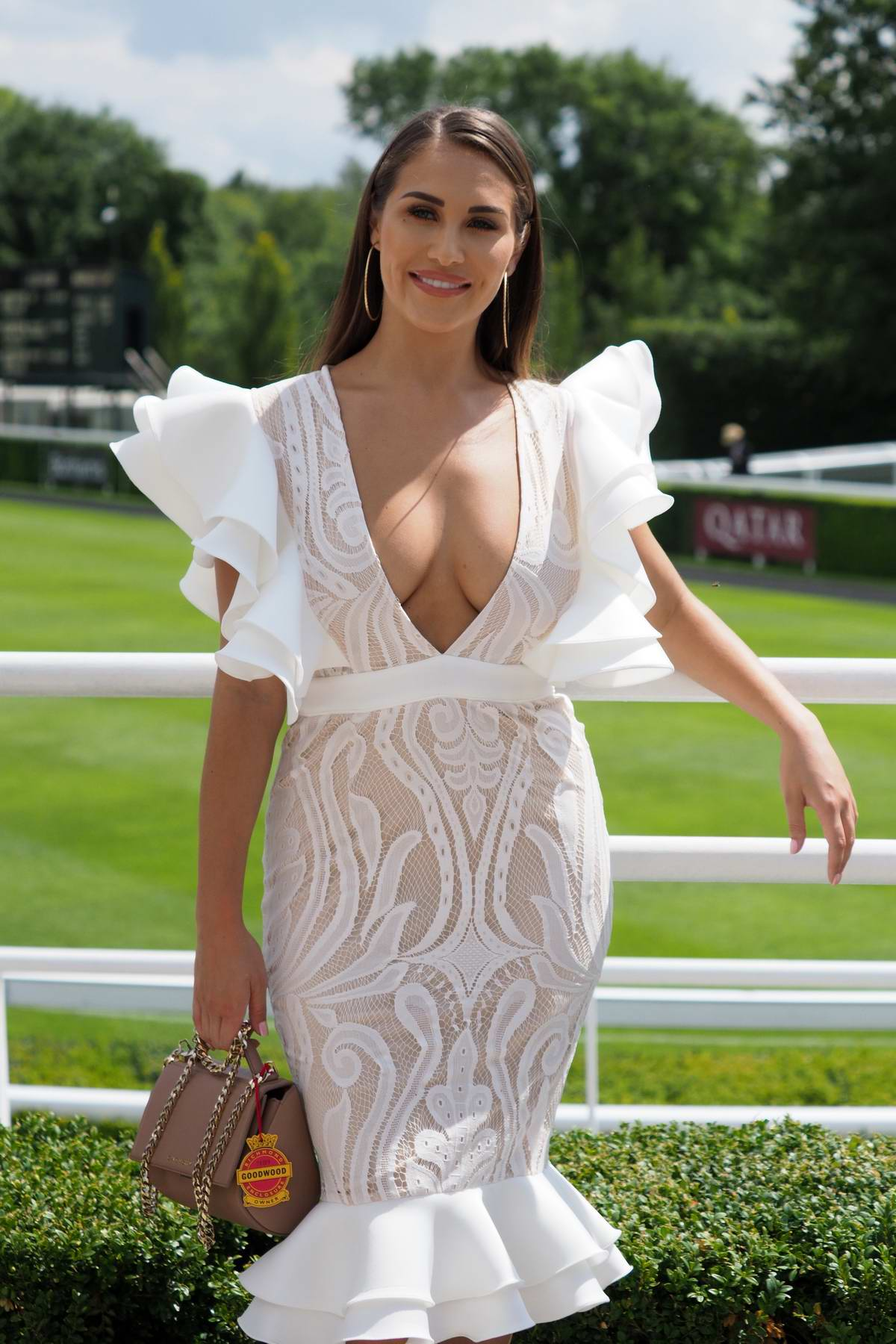 Chloe Goodman attends the Qatar Goodwood Festival at Goodwood Racecourse in Chichester, West Sussex, UK