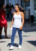 Christina Milian is all smiles as she greets customers at her Beignet Box food truck in Los Angeles