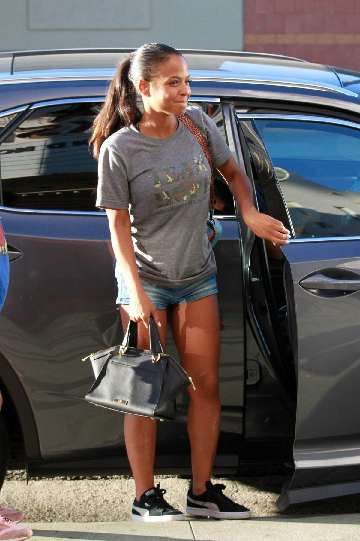 Christina Milian keeps things casual as she arrives to work at her Beignet Box mobile unit in Los Angeles