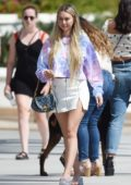 Corinne Olympios wears a white mini-skirt and a tie-dye while out with a friend in a Los Angeles