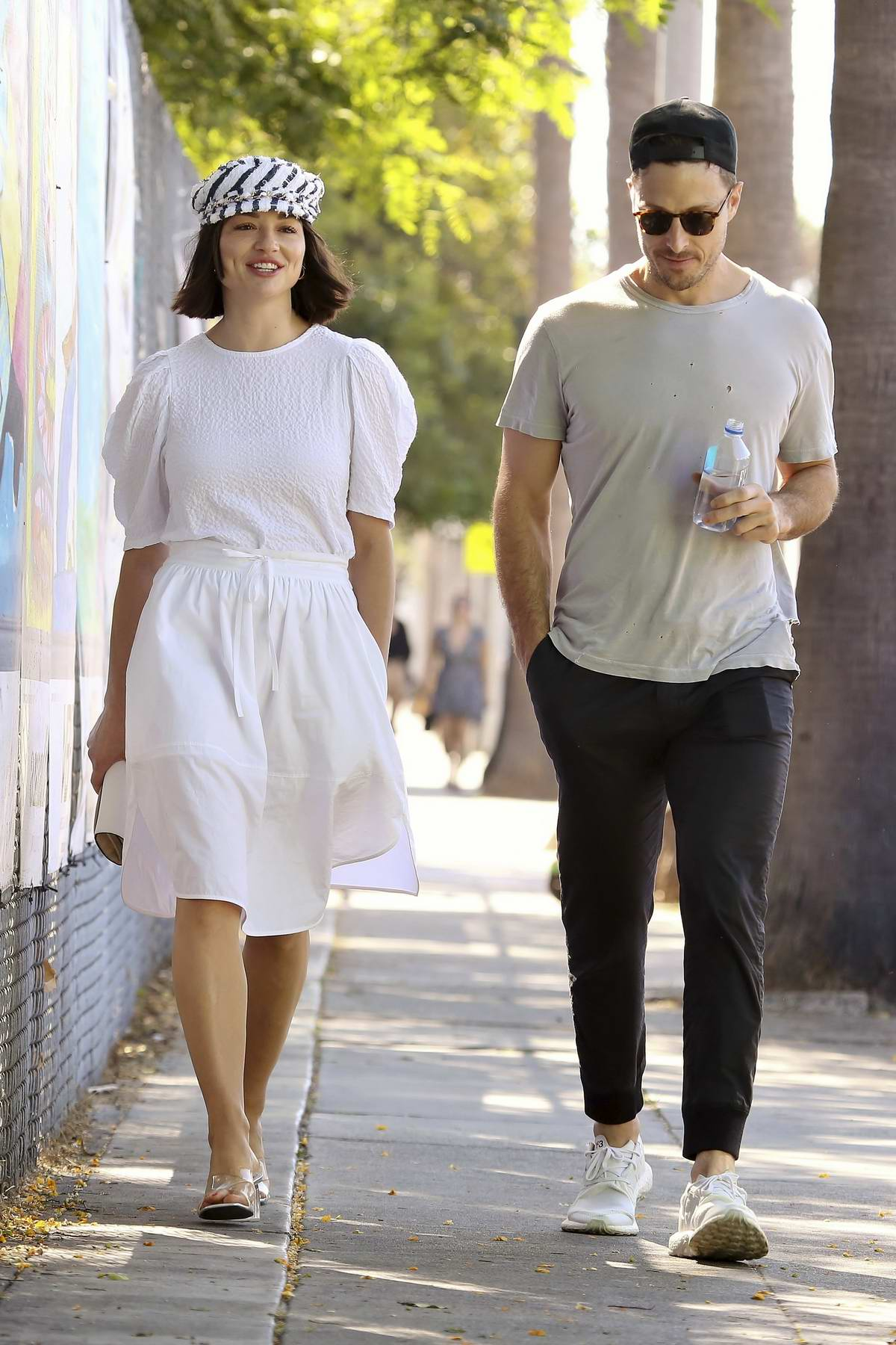 Crystal Reed wears a white dress while out for some coffee with a male friend in Los Angeles
