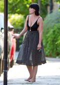 Daisy Lowe spotted in a low-cut black top and semi sheer polka dot skirt as she stepped out barefoot in London, UK