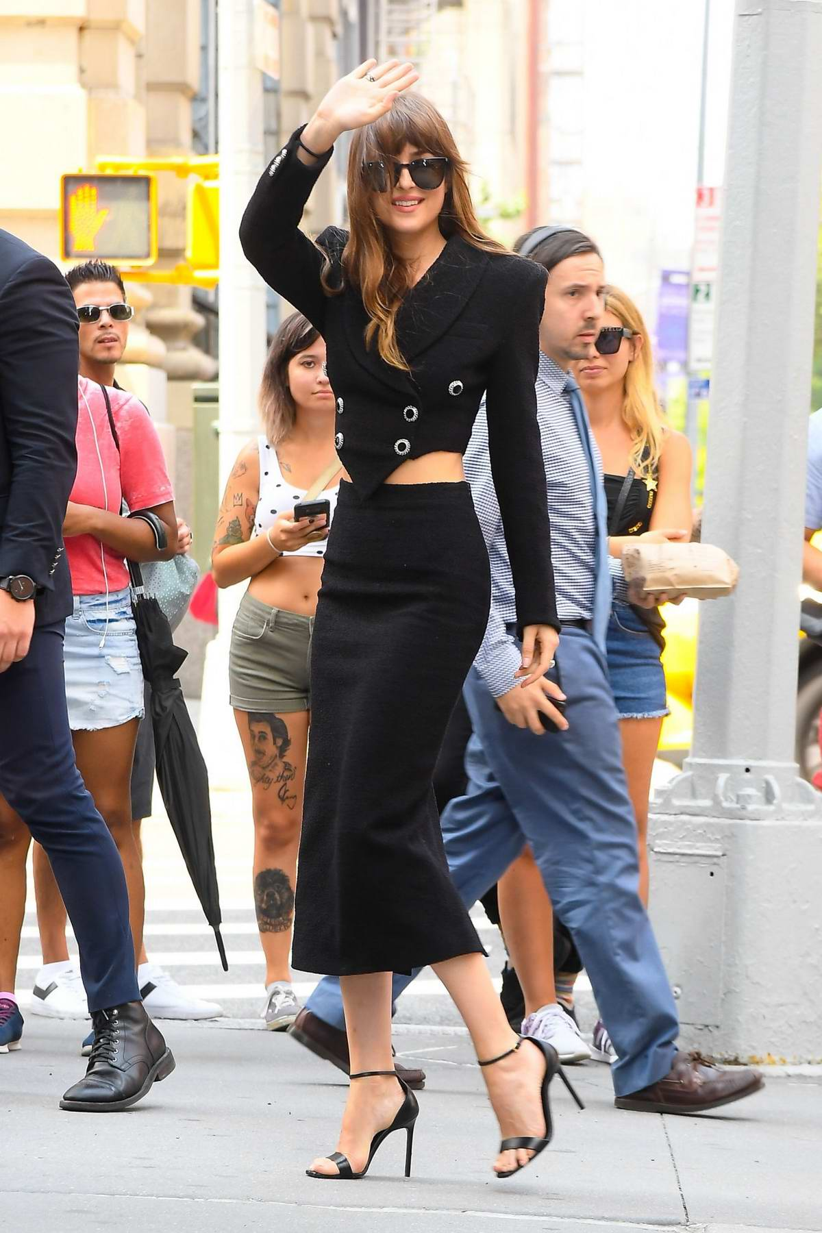 Dakota Johnson looks stylish in a black outfit while promoting 'The Peanut Butter Falcon' at a radio station in New York City