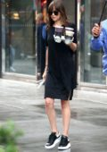Dakota Johnson picks up a few juices before boarding a helicopter with Chris Martin's Son in New York City