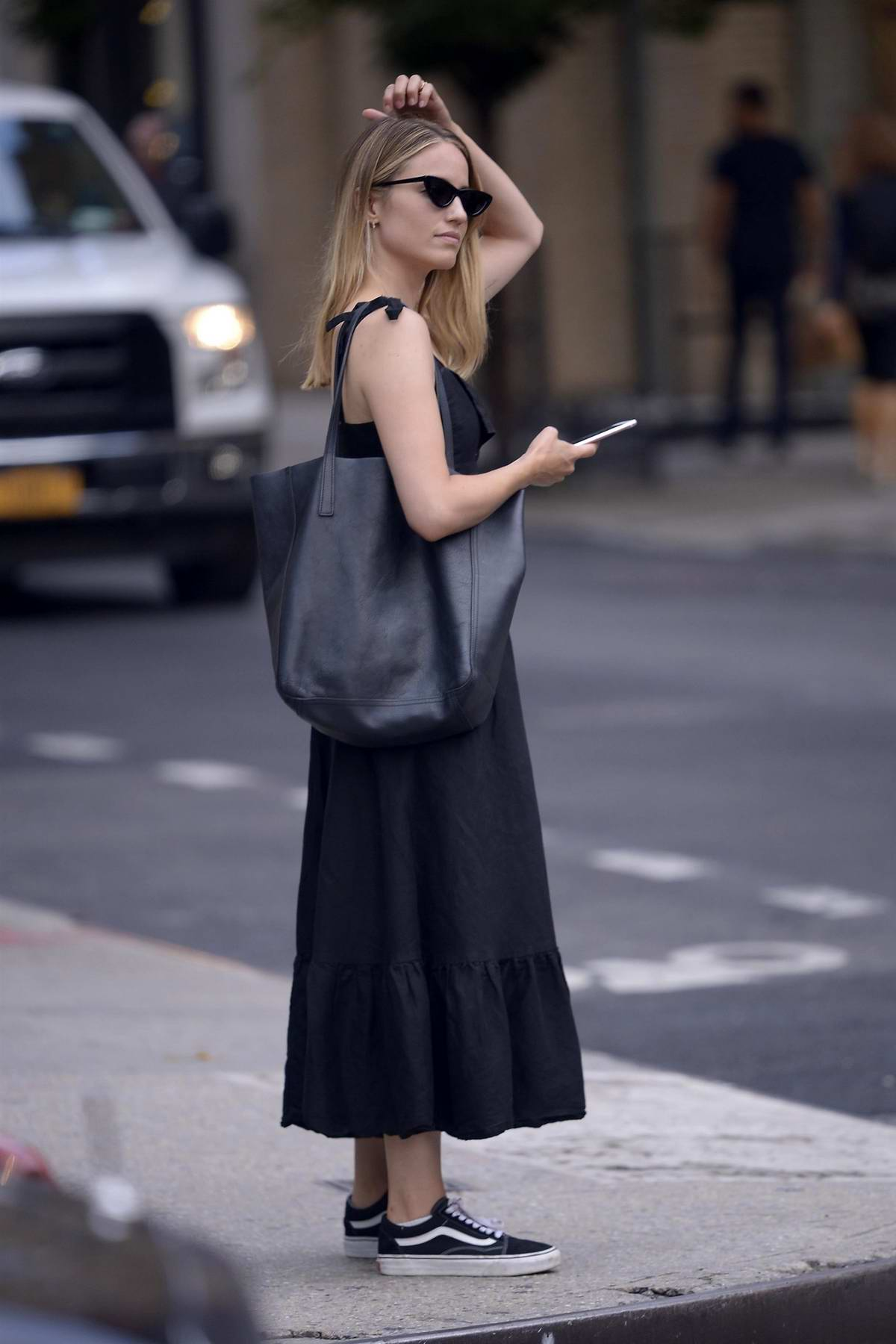Dianna Agron stepped out in a black summer dress in New York City