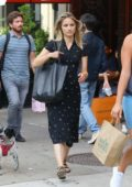 Dianna Agron wears a star print black dress with matching sandals and handbag while out for a stroll in New York City